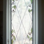 Bathroom window for a private residence in Brewster. Combination leaded mullions with foil wrap details, the floral designs match an existing tile border.