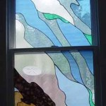 "Two-part bathroom window titled ""Brewster Flats."" Reminiscent of the tidal pools along the seashore, etched shells and marine life."