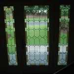 Leaded glass panels with hand drawn antique restoration glass, bevels, and mottled lined border. Bob & Peggy Orr residence, Cape Cod, Mass.