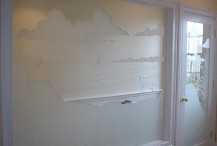 Dual surface etched glass beach scene on panel and door for a master bedroom in Osterville, MA.