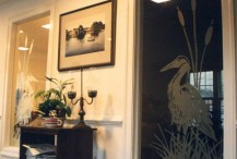 Large panels etched with Herons and marsh scenes for offices.