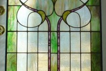 Originally two very old separate windows with blue borders. Removed them from their frames, discarded the borders, then joined them in a single panel for the center of a pocket door in their Cape home.