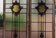 Pair of imported (English?) leaded glass windows originally purchased from a Salvage Company. Glass was intact but both panels required complete re-leading and weatherproofing.