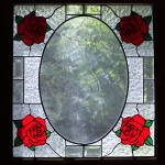 Simple rose panel for front door. Designed to match fabric and carpet in front hall. Glass selection by client.