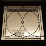 Simple leaded Victorian panel with faceted jewels, stipple white border and antique clear glass.