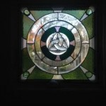 Leaded Celtic panel for private residence. Features hand-beveled dalle-de-verre jewels, clear beveled glass and salvaged antique mossy green glass.
